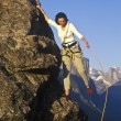 Rock climber clinging to a cliff. — Stock Photo #5940751