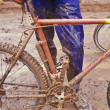 Stock Photo: Muddy mountain bike and rider.