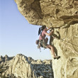 Rock climber clinging to a cliff. — Stock Photo #5940875