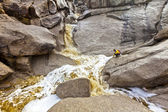 Hiker explores a cascading waterfall. — Foto de Stock