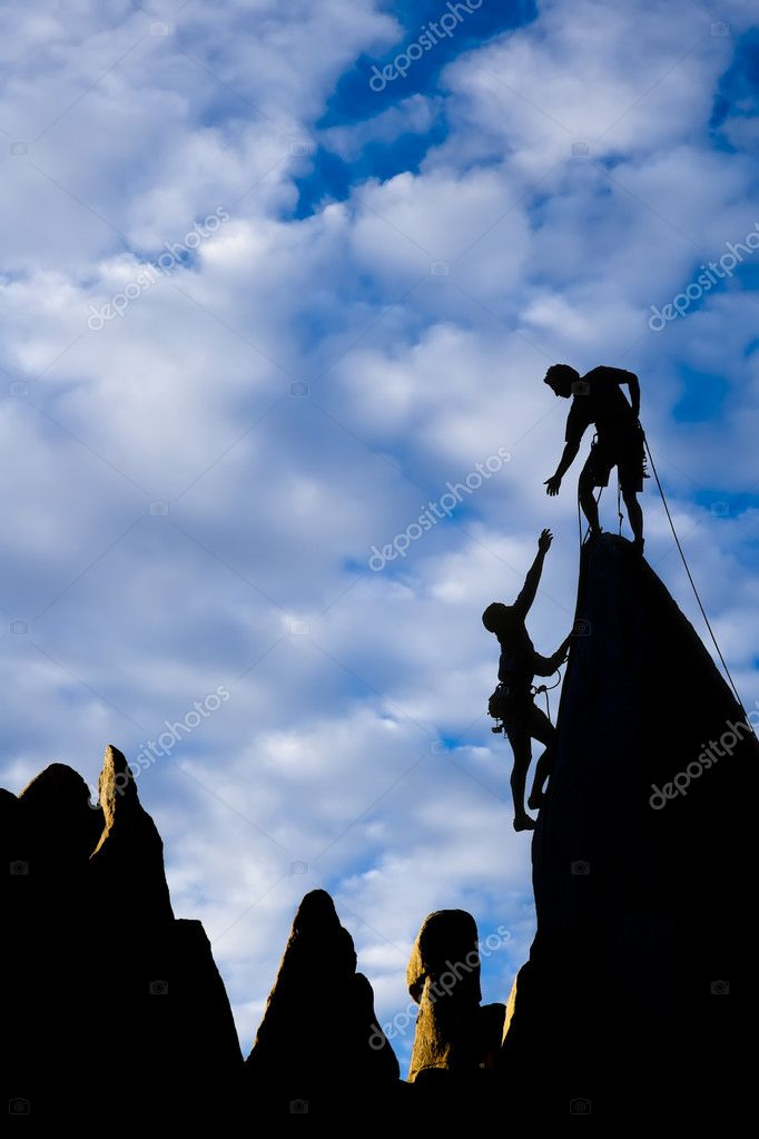 Team of climbers reaching the summit of a rock pinnacle in The Sierra Nevada Mountains, California.   #5941610