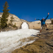 Hiker treking along cascades. - Stock Photo