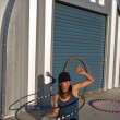 Woman practices with her hula hoop. — 图库照片 #5956878