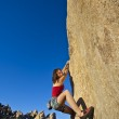 Young woman rock climbing. — Stock Photo #5956891