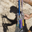 Climber organizing gear. - Stock Photo