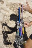 Climber organizing gear. — Stock Photo