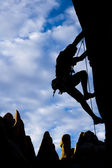 Rock climber silhouetted. — Stock Photo