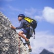 Young boy rock climbing. — Stock Photo