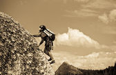 Young boy rock climbing. — Stock Photo