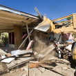 House being demolished. - Stock Photo