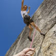 Rock climber and safety rope. — Stock Photo