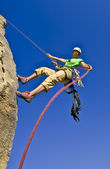 Rock climber rappelling. — Stock Photo