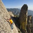Rock climber reaching. — Stock Photo