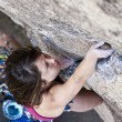 Female rock climber. - 图库照片