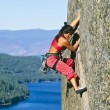 Rock climber clinging to a cliff. — Stock Photo #6450379