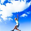 Runner jumping over a boulder. — Stock Photo