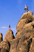 Rock climbing team reaching the summit. — Stock Photo