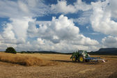 Tractor going to work in the field — Stock Photo