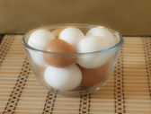 Eggs in a glass bowl — Stock Photo
