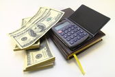 Dollars,note-book and calculator — Stock Photo