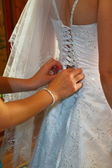 Trying on of wedding-dress — Stockfoto
