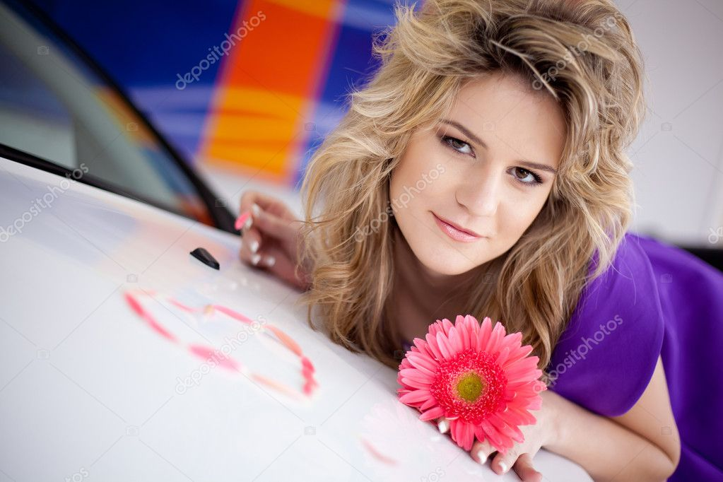 Young woman with flower and New car  Stock Photo #5547100