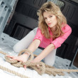 Pretty young woman in ropes in cargo van inside — Stock Photo