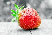Juicy strawberry on black and white — Stock Photo