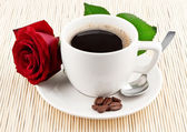 Cup of coffee and red rose — Stock Photo
