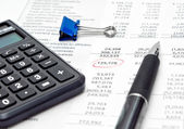 Financial report with calculator and pen — Stock Photo