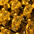 Stock Photo: Array of golden statues