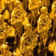 Array of golden statues — Stock Photo