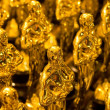 Array of golden statues - Stock Photo