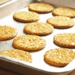 Tray of sesame biscuits — Stock Photo