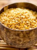 Bowl of yellow split peas — Stock Photo