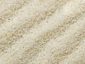 Raw polished white rice — Stock Photo