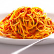 Spaghetti noodles in tomato sauce - Stock Photo
