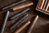 Cigar on a dark background — Stock Photo
