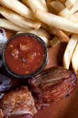 Grilled skewers with sauce and potatoes — Stock Photo