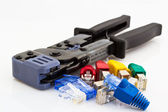 Cat5 cable jacks and crimping tool — Stock Photo