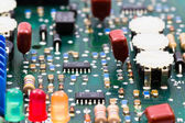 Green electronic board with regulatory elements — Stock Photo
