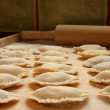 Pierogi na stolnicy - Foto de Stock  