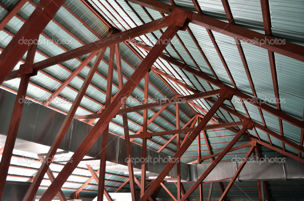 Space under roof trusses in newly-built house — Stock Photo #5860948