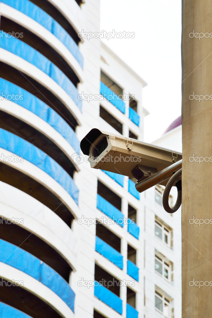Surveillance camera mounted on the pole to oversee construction site — Stock Photo #5867341