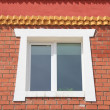 Wall brick building with a window — Stock Photo #5841803