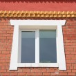 Wall brick building with a window — Stock Photo