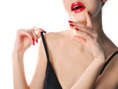Red lips and manicure — Stock Photo
