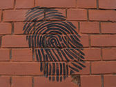 "Graffiti ""Fingerprint"" on a brick wall — Stock Photo"
