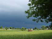 The storm sky over village — Stock Photo