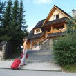 The tourist goes to a country house to Zakopane, Poland - Stock Photo